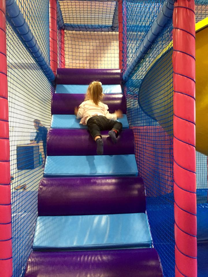 Young girl climbing the stairs in the Soft Play
