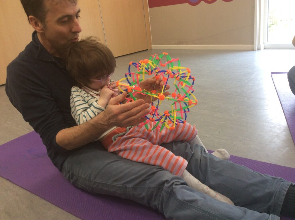 Image of dad doing Yoga with his daughter