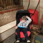 Image of a child sitting in the Medium Delta Buggy