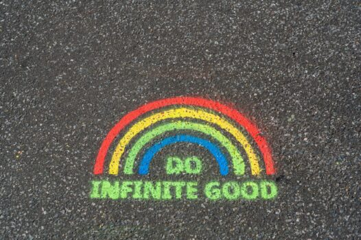 Graffiti on the ground saying 'Do Infinite Good'